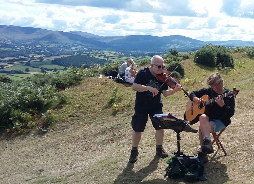 Jo and Dave playing at a Mind Charity event near the Brecon Beacons, July 2019